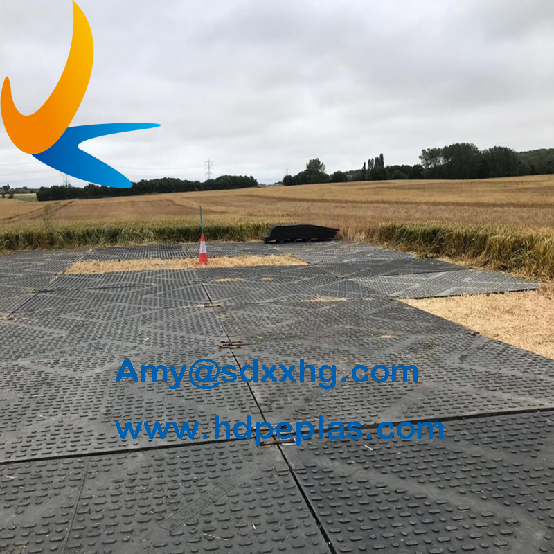 Heavy duty ground protection mats in construction site