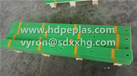 Green HDPE wear resistant strips with holes.